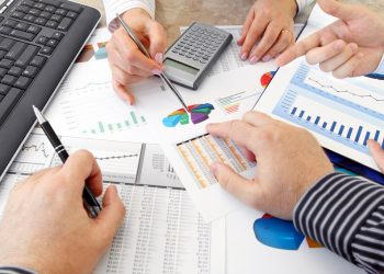 Hands with Financial  Charts  at Business Meeting in the Office